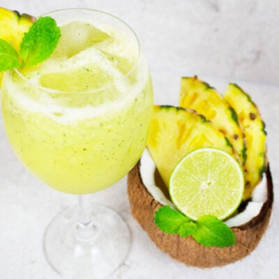 pineapple mocktail garnished with mint and fresh pineapple