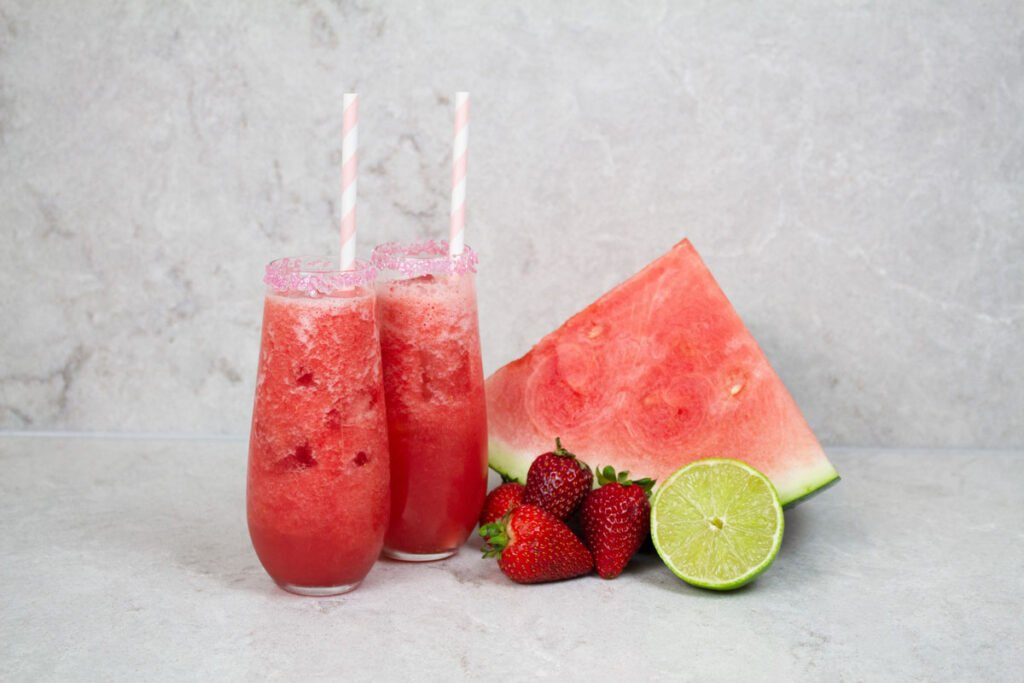 2 strawberry mocktails with pink and white striped straws
