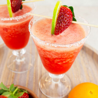 virgin strawberry daiquiris with a white salt rim with strawberry and lime on top