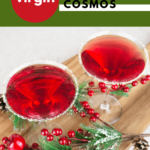 Christmas cosmopolitan recipe Birdseye view with a lime and sugar rim and Christmas decorations