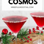 2 virgin cosmopolitan drinks with a lime and sugar rim on a wooden board with Christmas decorations