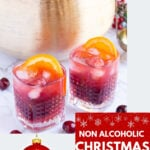 alcohol free Christmas punch in 2 glasses garnished with orange slices