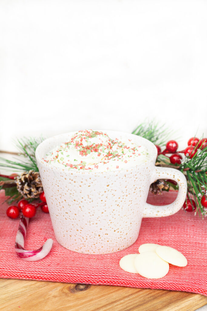 white hot chocolate on a red tea towel with Christmas decorations