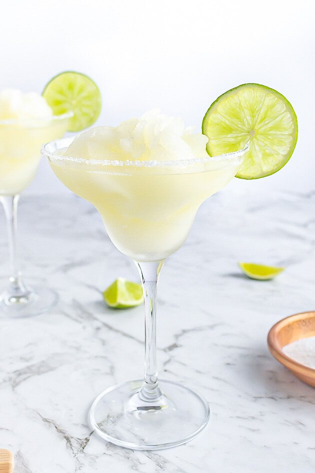 margarita mocktail in a classic glass with a salt rim and lime wheel for garnish