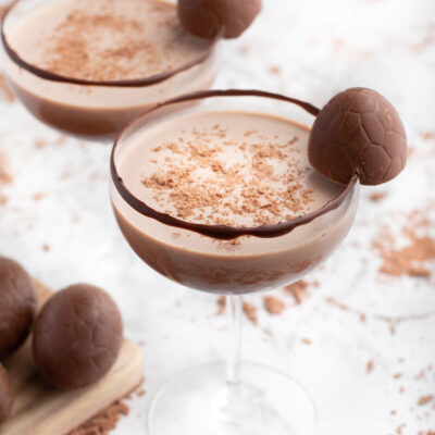 chocolate mocktail in a coupe glass with Easter egg garnish
